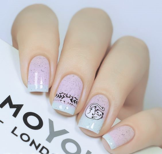 Pastel pink and mint manicure with glitter and cat decor