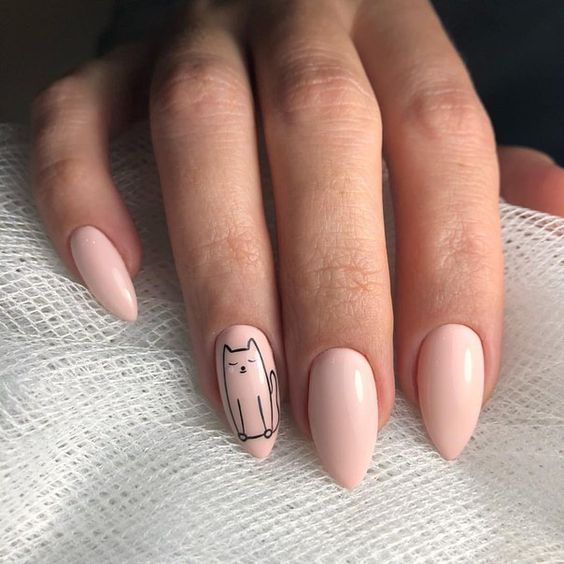 Almond style beige tone manicure with decorated cat silhouette