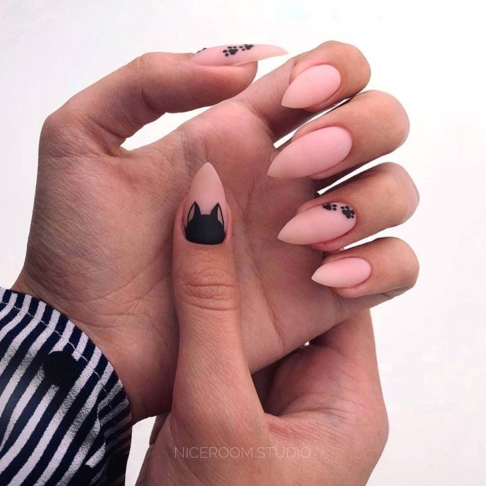 Almond pastel pink tone manicure with black cat decor