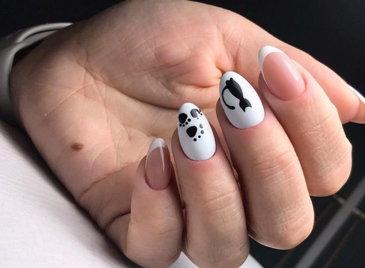 White manicure with decorated black cat silhouette