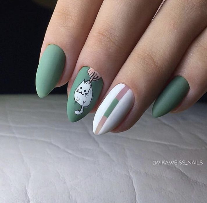 Green manicure with white cat decoration and white stripes