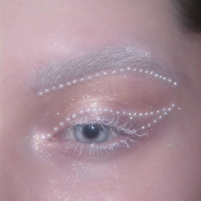 Eye makeup with white mascara and white pearls