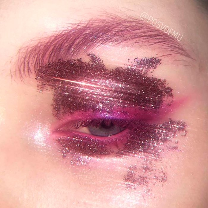 Fuchsia pink eye makeup and same color glitter