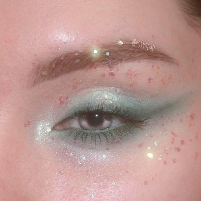 Aqua eye makeup and gold glitters