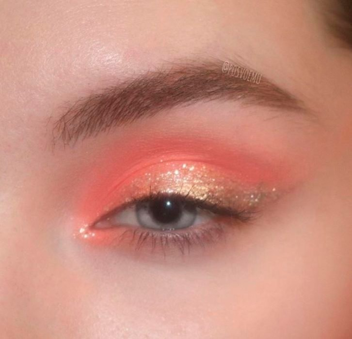Coral and bronze colored eye makeup