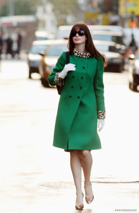 Scene from the movie El Diablo Dress up fashion. Andrea walking down the street wearing a green coat