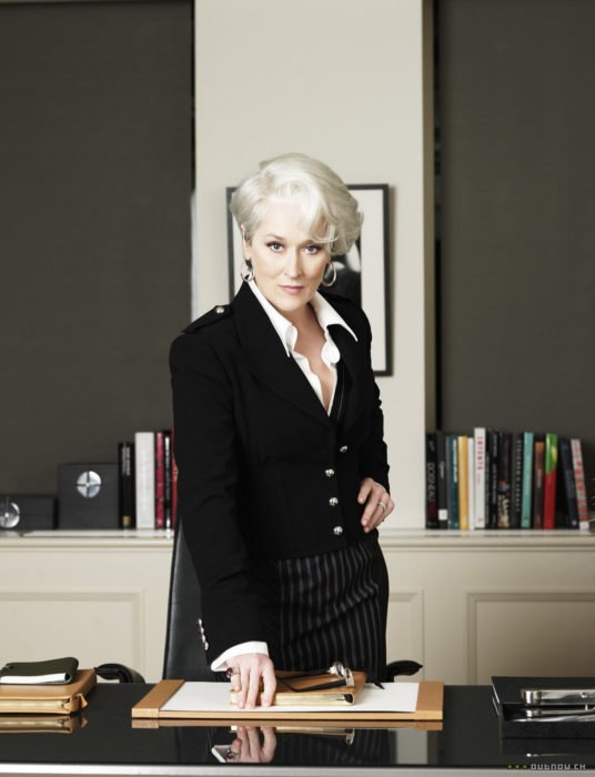 Scene from the movie El Diablo Dress up fashion. Miranda in her office wearing a stylish black outfit