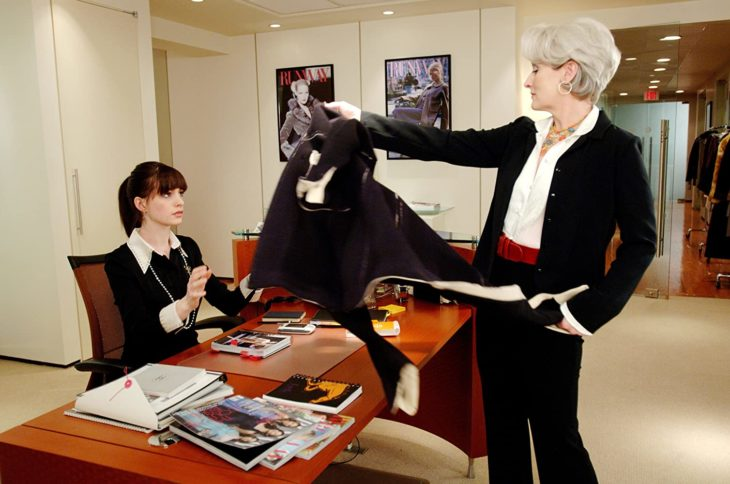 Scene from the movie El Diablo Dress up fashion. Miranda handing Andrea her black coat