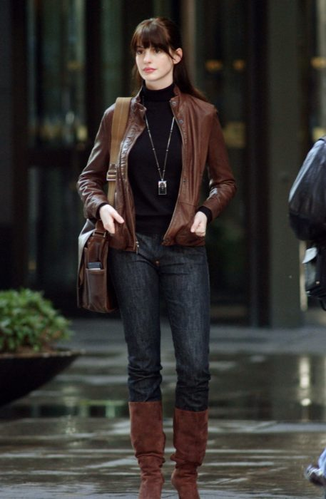 Scene from the movie El Diablo Dress up fashion. Andrea wearing a jeans, boots and jacket look while standing on a street