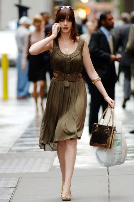 Scene from the movie El Diablo Dress up fashion. Andrea walking the streets while wearing a green dress