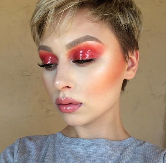 Pixie short hair blonde girl with orange glossy effect eye makeup