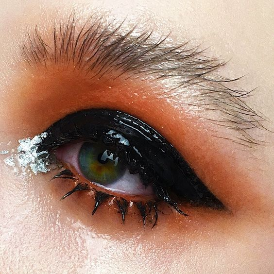 Black glossy makeup with orange
