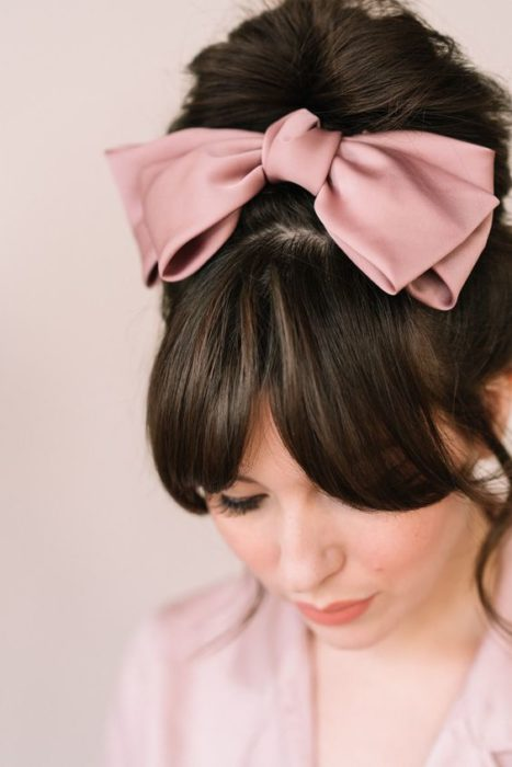 High chongo with fringe and big pink bow