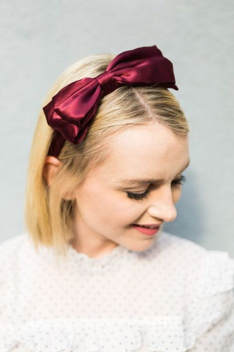 Blonde girl with short hair with icing bow