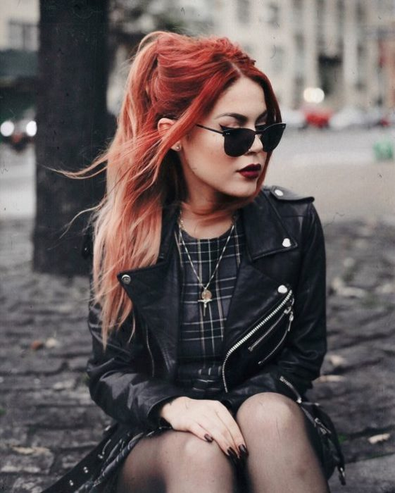 Red haired girl with sunglasses and black outfit