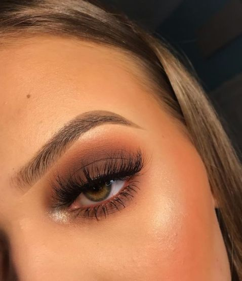 Smoky makeup with brown and orange shade