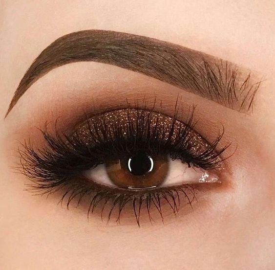 Eye makeup with brown shadow and glitter