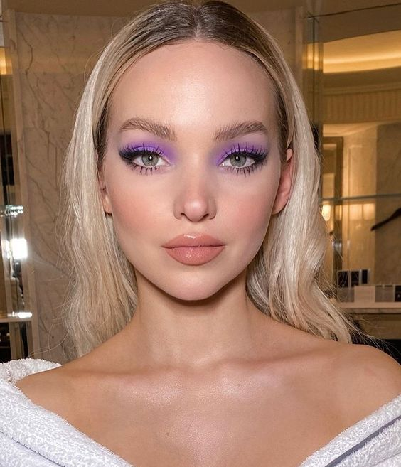 Long hair blonde model loose with purple eyeshadow