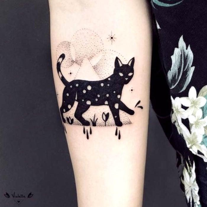 Cat tattoos; Black feline arm tattoo