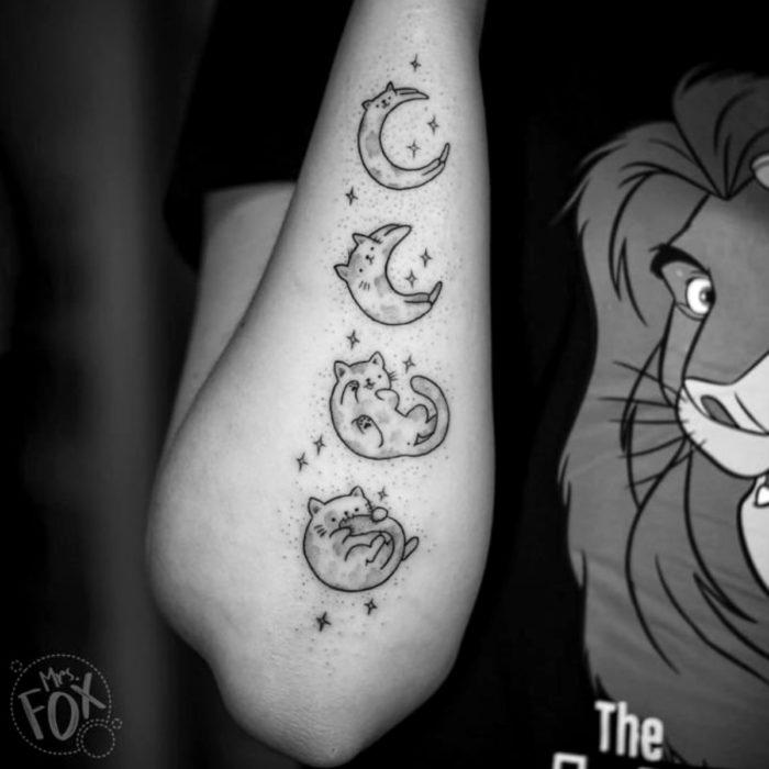 Cat tattoos; Cute feline arm tattoo