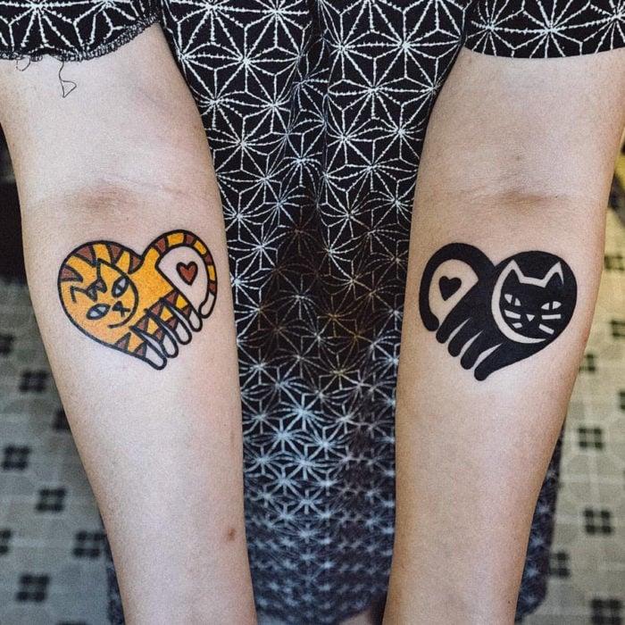 Cat tattoos; Black and yellow striped feline arm tattoo
