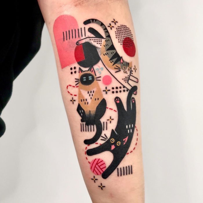 Cat tattoos; Siamese feline arm tattoo, gray with stripes and black with yellow eyes, surreal, cubism