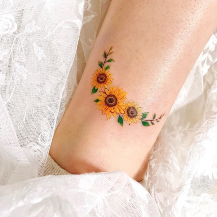 Small sunflowers crown tattoo on arm