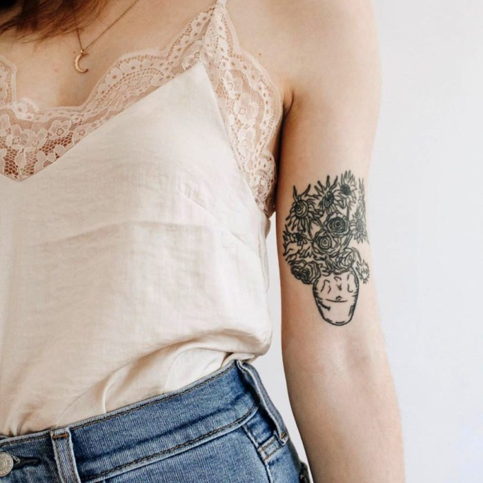 Sunflowers tattoo by Vincent Van Gogh on the arm