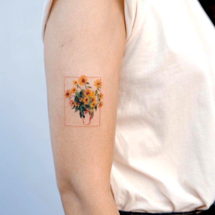 Sunflowers in vase tattoo on arm