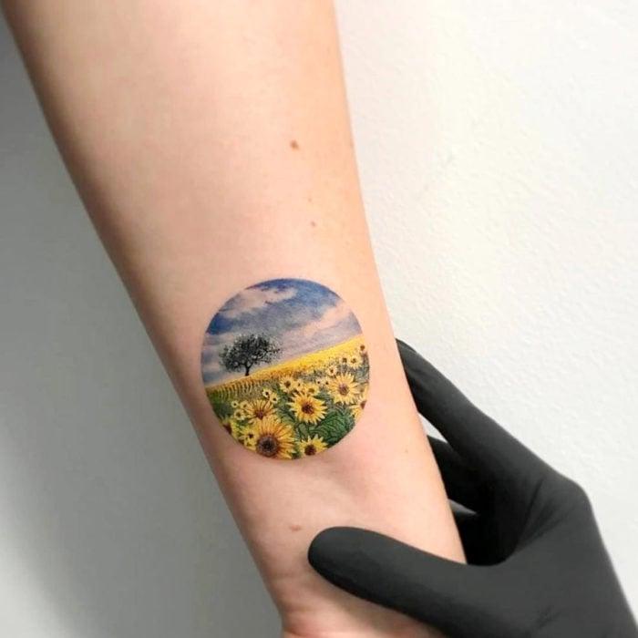 Miniature sunflowers tattoo on arm, flower field landscape