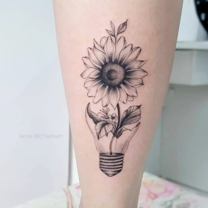 Black and white sunflowers tattoo with spotlight pot