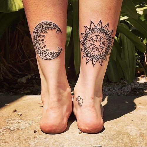 Mandala moon and sun tattoo on woman's ankles