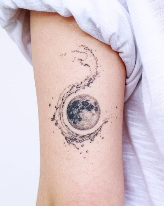 Moon tattoo surrounded by sea waves