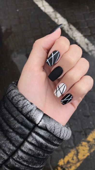 Black and white manicure with inverted lines
