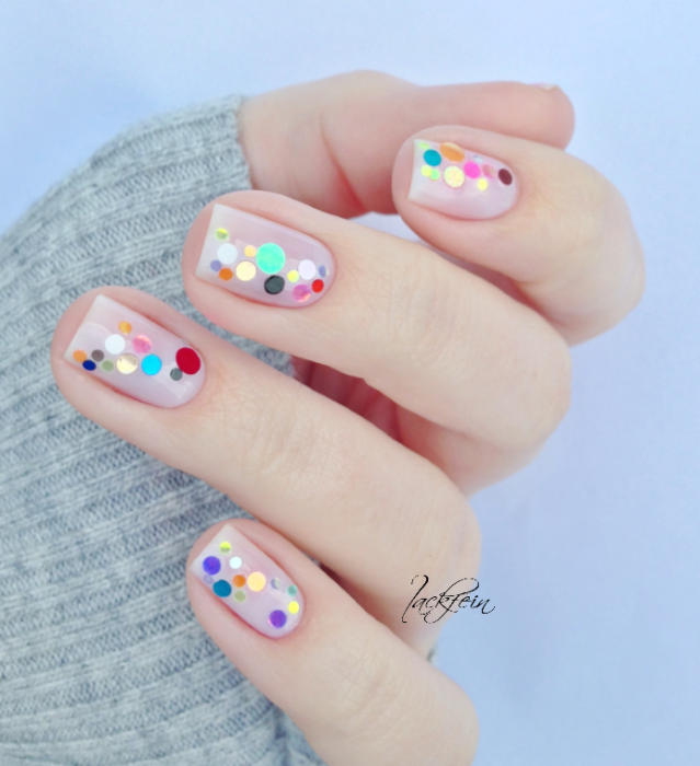Manicure with rainbow applications