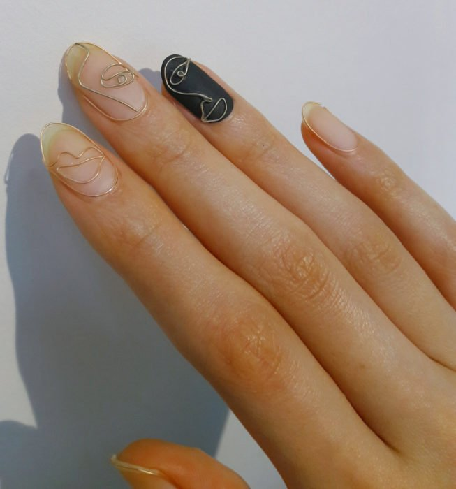Picasso style almond nails, gold manicure with black
