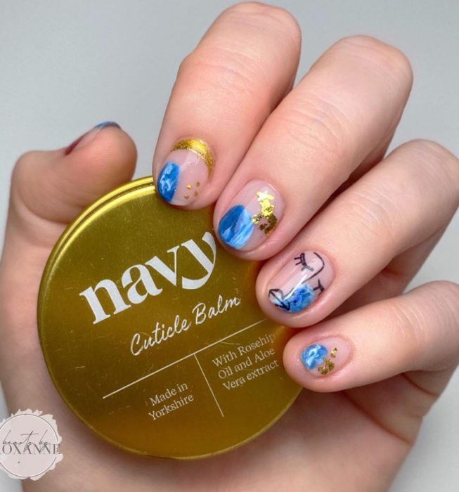 Short Picasso style nails, blue and gold manicure