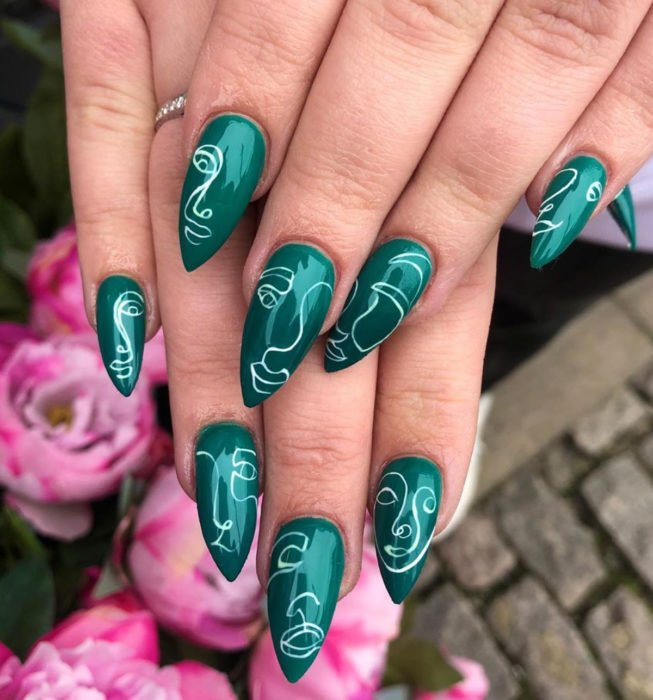 Picasso style stiletto nails, leaf green manicure
