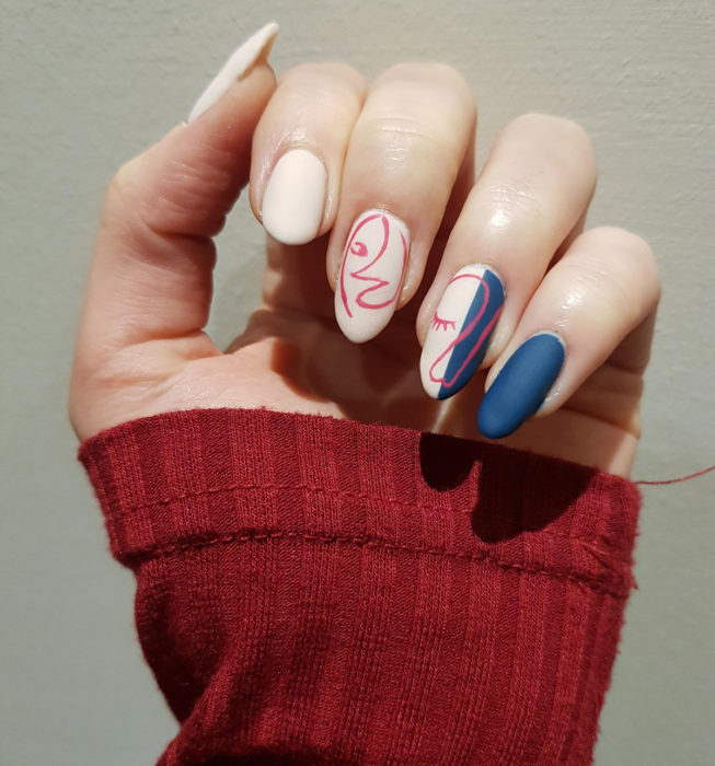 Almond Picasso style nails, nude manicure with denim blue