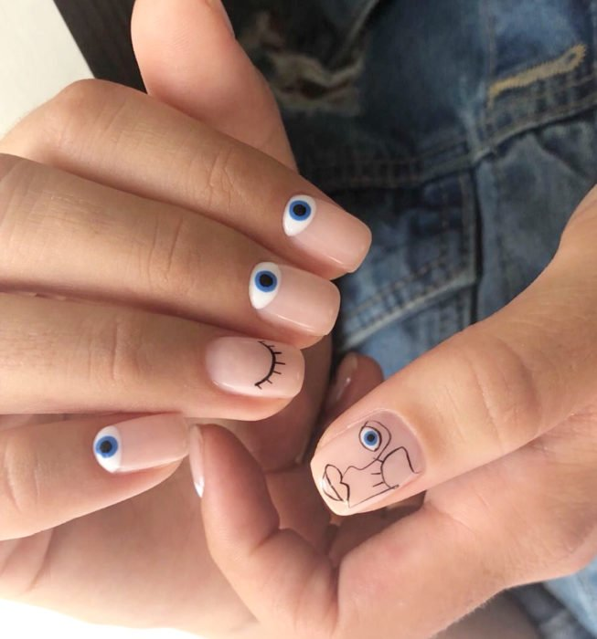 Square Picasso style nails, nude manicure with eyes