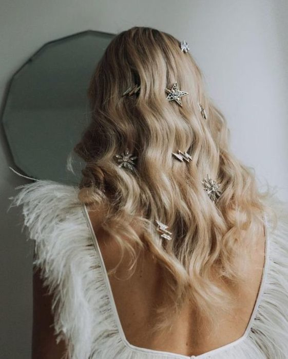 Blonde girl from behind with loose hair and star barrettes