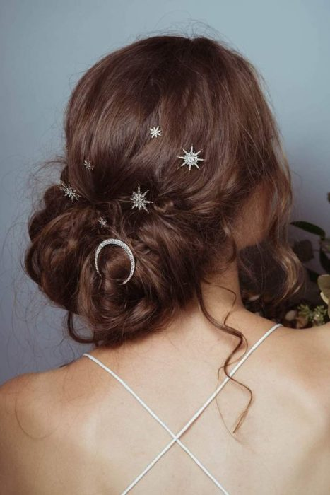 Light brown hair girl with tousled bun and star brooches