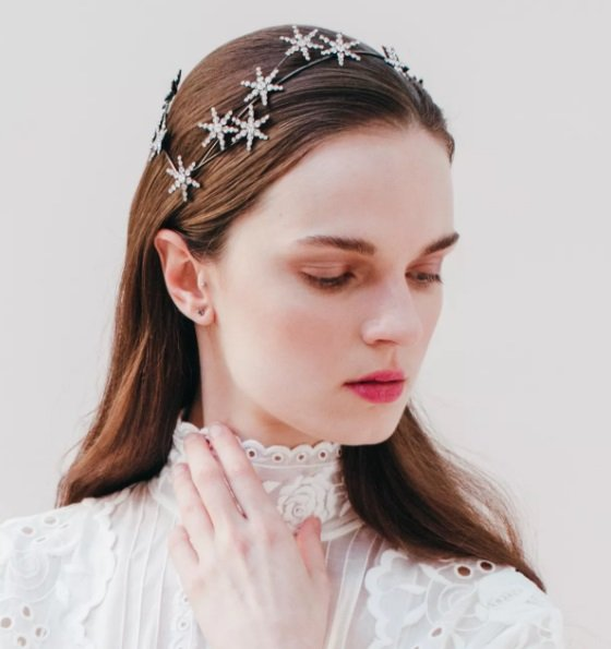 White girl with wedding dress and loose hair wearing star headdress