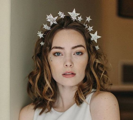 Short hair curly girl with 3D star headband