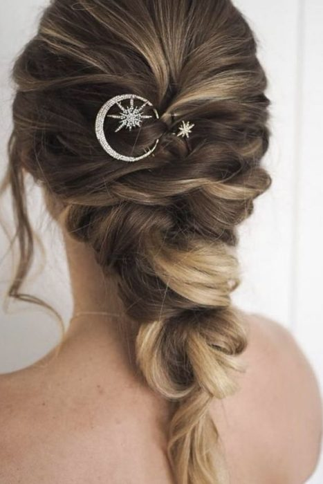 Blonde hair bride with tousled updo with moon and star brooch