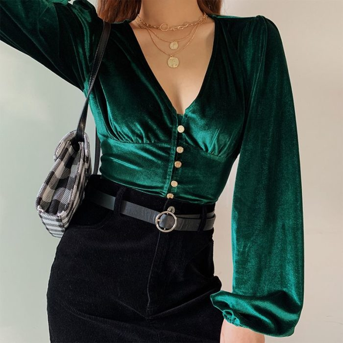 Blouse with neckline, velvelt green color, with buttons on the front and loose long sleeves