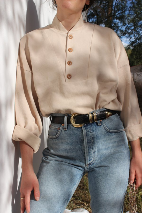 Girl wearing beige button-down long-sleeved blouse