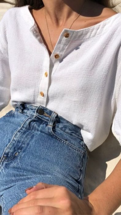 Girl wearing jeans and white button-down blouse
