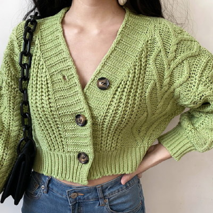 Girl wearing green button down blouse with V neckline and long sleeves