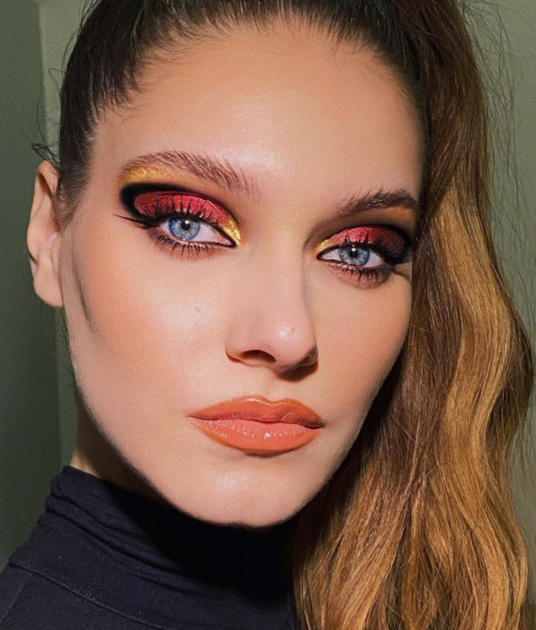 Blue-eyed girl, copper-brown ponytail hair, party evening makeup, blurred graphic liner, copper-red and gold eyeshadow, peach lipstick